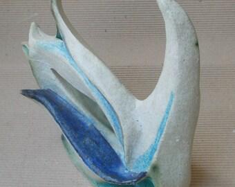 White bird sculpture.Circle bird. Contemporary ceramic .