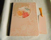 Altered/Covered composition book peach silver dazzles with book mark