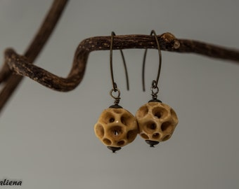 Carved bone antique stained earrings with almond shaped ear wires