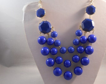 3 Strand Bib Necklace with Navy Blue Pendants on a Gold Tone Chain