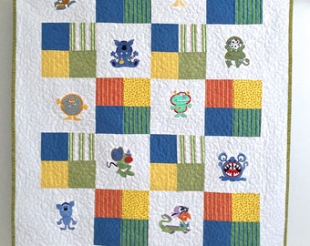 Toddler Quilt Featuring Colorful Embroidered Monsters