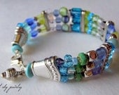 Multi Strand Memory Wire Caribbean Inspired Bracelet. Vintage faceted Rondelles ,Blues and greens glass beads with BLING SPACERS