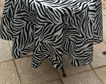 "Overlay 60"" round White taffeta with black velvet flocking in zebra pattern."