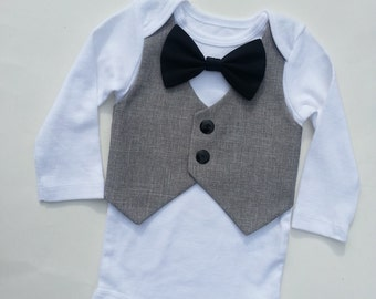 Baby Boy Bodysuit With A Grey Vest Attached And A Black Bow Tie.