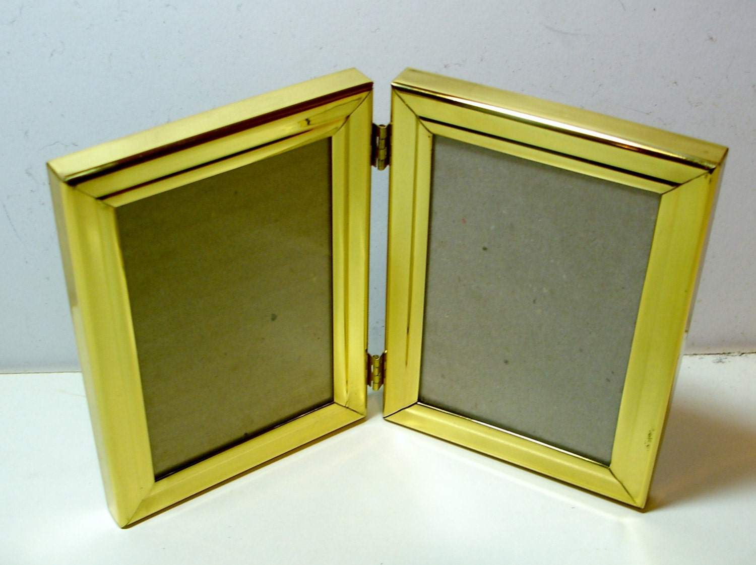 Double gold tone photo frame that closes like a book for photo sold by eldees jeuxipadfo Gallery