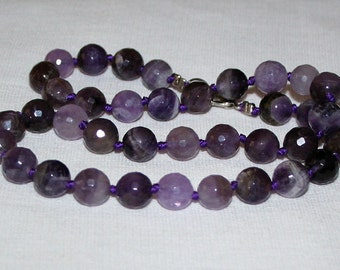 10 mm faceted amethyst beads.