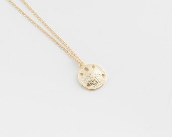 Gold charm necklace | Sand dollar necklace, Simple beach necklace, Tiny necklace, Dainty gold necklace, Gold disc necklace