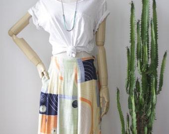90s midi skirt. Mint yellow pleat skirt. 90s abstract skirt. Pastel Drop waist skirt. Medium