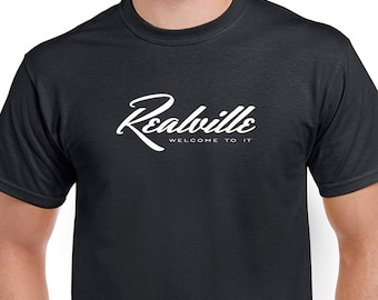 Realville, Welcome To It T-shirt. Conservatives are sure get a rush out of this shirt. Direct screen printed with White ink.