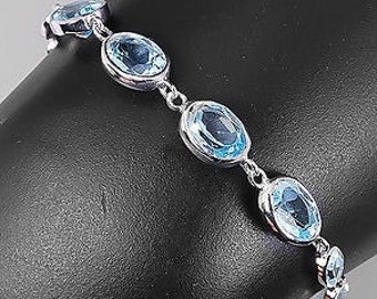 From E45 for E20...Blue saphire bracelet made with sterling silver.