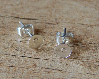 20pcs. (10 pairs) stud earring blanks in shiny silver tone (back stoppers included)
