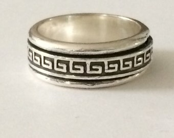 Size 7.5 Sterling Silver Ring Around A Ring