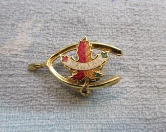 1970s gold-tone & enamelled Canada lucky wishbone brooch, souvenir pin