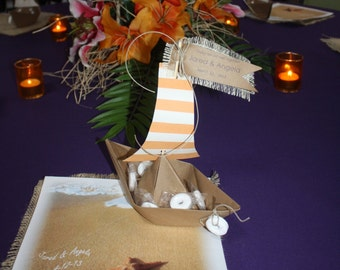 Paper boat favors filled with lifesavers