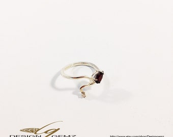 Genuine Garnet and diamond Ring