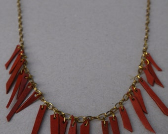 Gold chain and leather necklace orange woman