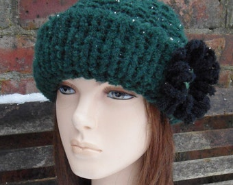 dark green wool brimmed winter warm hat with black crochet flower by irish granny