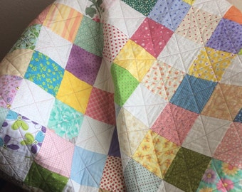 "It's A Scrap Happy Delight In This 40.5"" X 49.75"" Quilt"