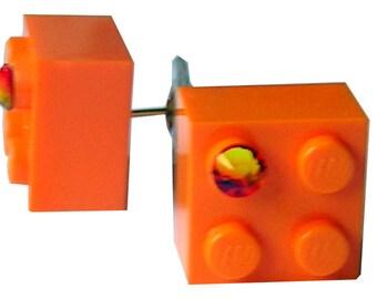 Orange LEGO (R) brick 2x2 with an Orange SWAROVSKI crystal on a Silver/Gold plated stud
