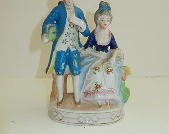Colonial man & Woman-Occupied Japan 1940s ceramic Figurine-mid century Japan-Standing Man Blue Coat Seated Woman Couple Colonial Porcelain