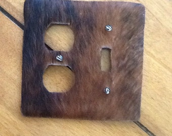 Horsehair covered switchplate socket cover