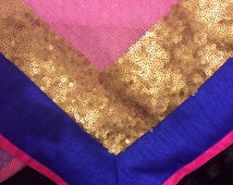 Beautiful pink saree fabric. 6 yards of cotton jute fabric with blue and gold sequinned border.