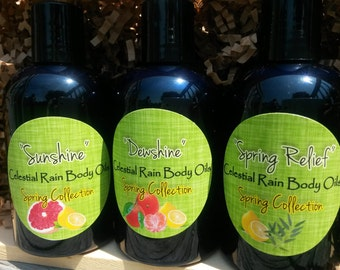 "3 4oz Bottles of Body Oil from the ""Spring Collection"", Sunshine, Dewshine, and Spring Relief"