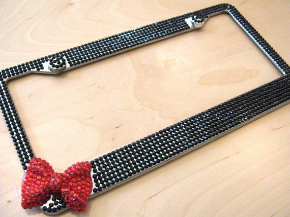 black bling rhinestone license plate frame w red bow on side and 2 caps