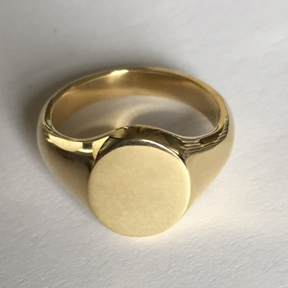 plain 9 carat yellow gold oval signet ring by signetcircle
