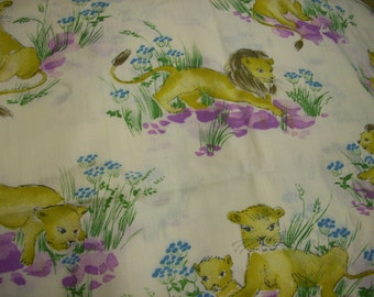Vintage Klopman Mills Lion Fabric from the 1970s there is 2 1/2 Yards and is very rare and oop cream back round