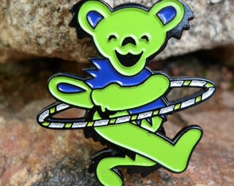 Lime green hula hooping grateful dead dancing bear