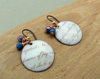 Torch fired enamel earrings with poetry