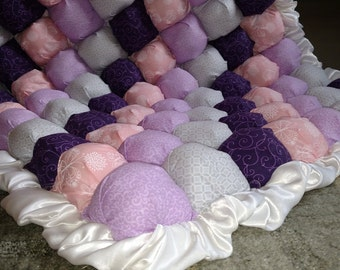 Purple, pink, and grey bubble blanket