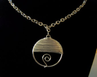 Silver necklace with wire wrapped pendant