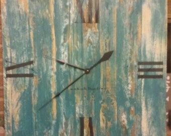 Weathered reclaimed wood wall clock with distressed paint