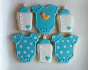 Baby boy shower, birthday  party sugar cookies decorated with royal icing ,onesie ,bottle,baby face ,mini cookies and large cookie