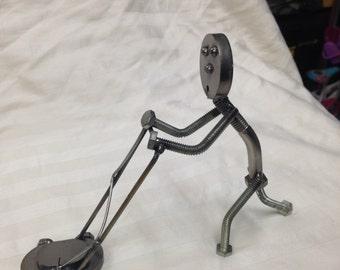 Welded metal art lawnmower man sculpture