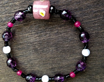 Black and purple beaded bracelet with pink lampwork bead