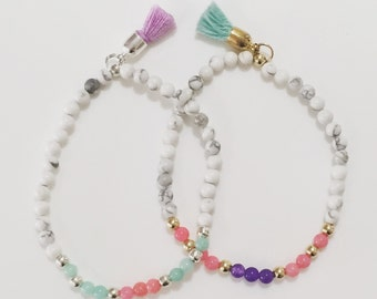 Beautiful semi-precious stacking bracelets with tassel charms