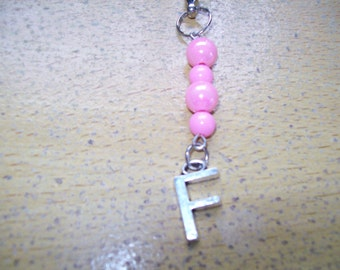 Pink beaded keyring with letter F