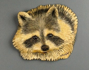 Raccoon carved on wood (face)