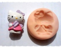 hello kitty push mold. made from polymer clay for polymer clay card making other crafts.