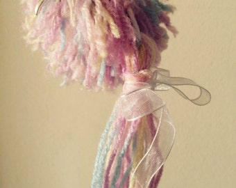 Handmade pom pom bagcharm. Made to order in a range of colours.