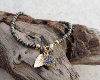 Pyrite bracelet with druzy and gold leaf charms