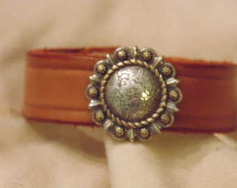 Leather band with flower medallion