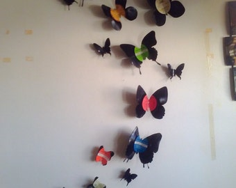 Vinyl record wall art. One of a kind, hand cut vinyl record butterfly set. 13 unique silhouettes of varying sizes.