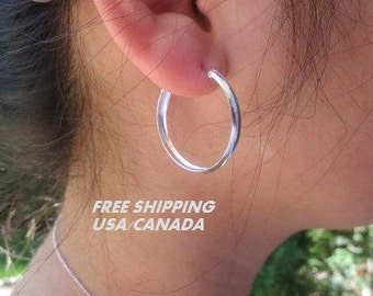Wide silver hoop earrings; 92.5 sterling silver