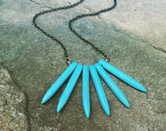 Handcrafted curved wire necklace with turquoise stone spikes