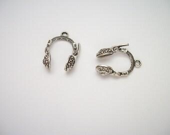 2 metal charms, music headphones, silver color, nickel free.