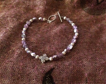 Purple cross bracelet